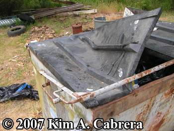 dumpster raided by a black bear. Photo copyright 2007 by Kim A. Cabrera.